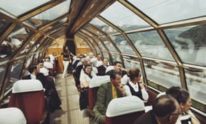 Passengers on a Trans Europe Express train travelling beside the River Rhine near Mainz in West Germany in 1971