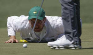 Matthew Fitzpatrick's caddie Jamie Lane helps line up a putt on the 2nd during the second round