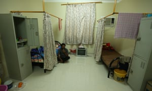 A labourer pictured in March in accommodation built to house 70,000 workers, some of whom work on World Cup projects.