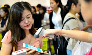 Chinese woman paying with smartphone