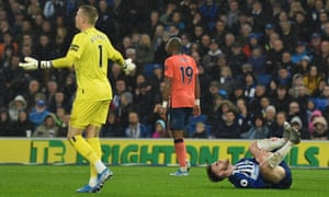 Everton's goalkeeper Jordan Pickford gestures as Brighton's Aaron Connolly lies on the pitch injured after a challenge with Everton's Michael Keane. VAR decided there was enough contact for a penalty.