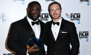 Director Steve McQueen, left, with actor Michael Fassbender who presented him with the award.