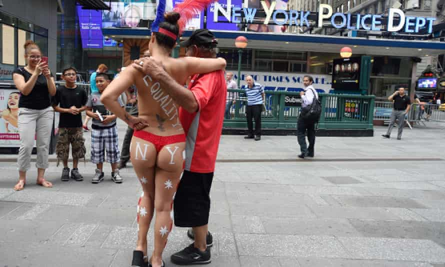 A 'desnuda' in body paint poses in Times Square in 2015. The controversy sparked calls to reinstate car traffic.