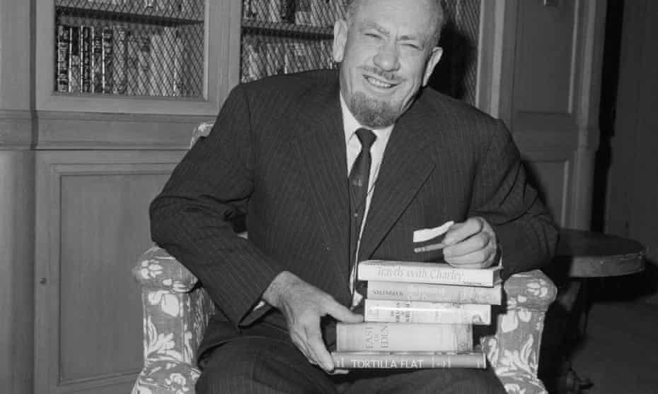 John Steinbeck with a stack of books