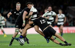Vince Aso gets hit by a shoulder tackle from Luke Romano as Anton Leinert-Brown tackles low during the Barbarians v New Zealand rugby union match at Twickenham Stadium