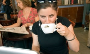 Woman using wifi in cafe