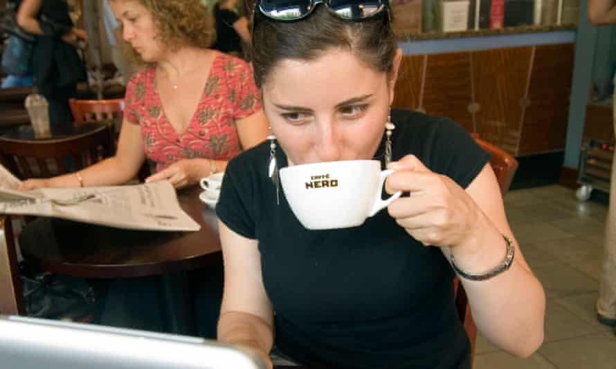 Woman using wifi in cafe