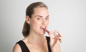 Mina Holland eating the ruby KitKat
