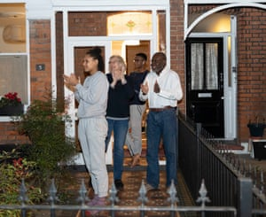 A family in east London take part in the clapping on their doorstep.