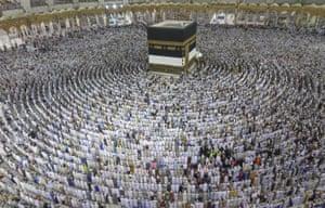 Muslims pray around the Ka'bah at the Masjid al-Haram during the Hajj pilgrimage in Mecca, Saudi Arabia