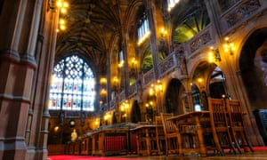 John Rylands Library interior with wood, carved stone and stained glass