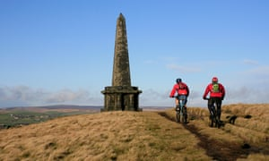 Cyclists on footpath at Stoodley Pike, Yorkshire