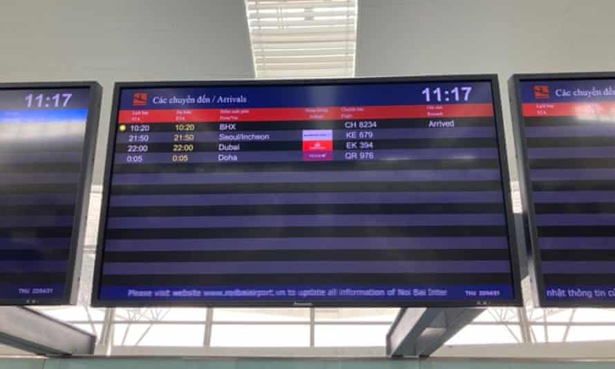 The arrivals board in Hanoi airport shows the arrival of the flight from Birmingham, UK.