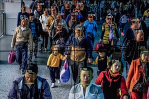 monitor demonstrating facial recognition software by megvii on people in a street in china