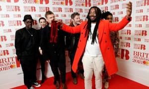 Gorillaz, winner of the best British band award in the Brit awards winners' room.