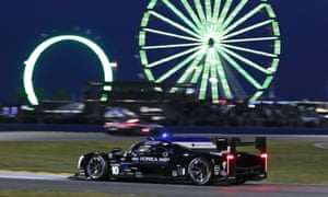 Fernando Alonso drives his Cadillac DPi during the evening hours of the 24-hour race at Daytona International Speedway