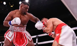 Jarrell Miller lands a punch against Tomasz Adamek as part of Eddie Hearn's first steps into the American market.