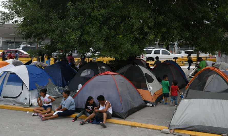Migrants, many of whom were sent back to Mexico under Migrant Protection Protocols, at a makeshift encampment in Matamoros, Mexico, on 24 August.