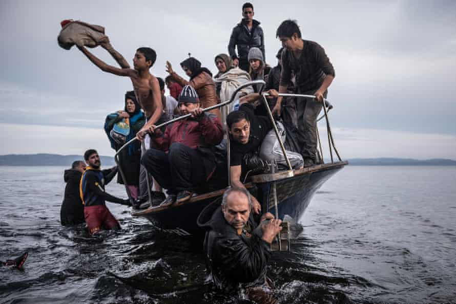 Nothing left to lose … migrants arrive at the Greek island of Lesbos, in a shot by Sergey Ponomarev.