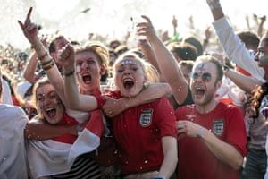 England fans celebrate England's first goal.