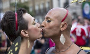Participants kiss as they take part in the annual Pride London parade.