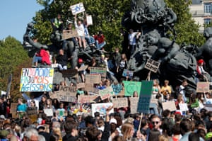 Students hold placards in Paris, France