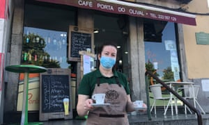 A waitress serves coffee outside at Café Porta do Olival in Porto