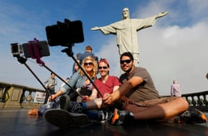 Tourists pose for selfies
