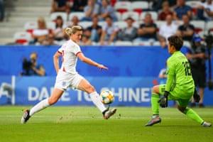 Ellen White of England scores the opening goal past Ayaka Yamashita of Japan.