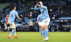 Phil Foden holds his head in his hands after shooting wide.