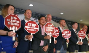 European parliamentarians display messages expressing alarm over the mounting number of killings in the Philippines. President Rodrigo Duterte has threatened to throw the EU out of the country.