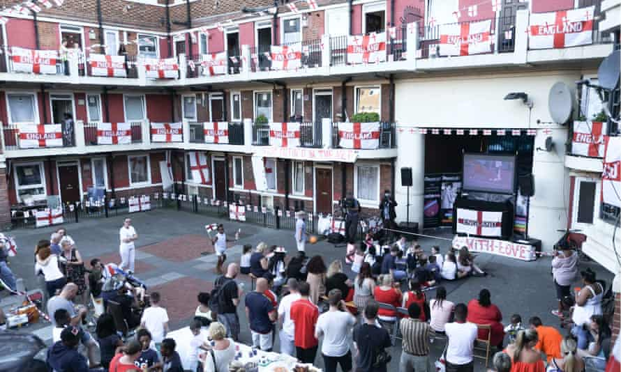 Football fans watch on a big screen at the Kirby Estate in Bermondsey, London.