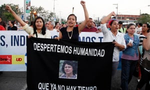 Lidia Marcela Zuniga Caseres, center, daughter of Berta Cáceres, leads the march to demand justice over the murder of her mother, in Tegucigalpa, Honduras, Friday 1 April.