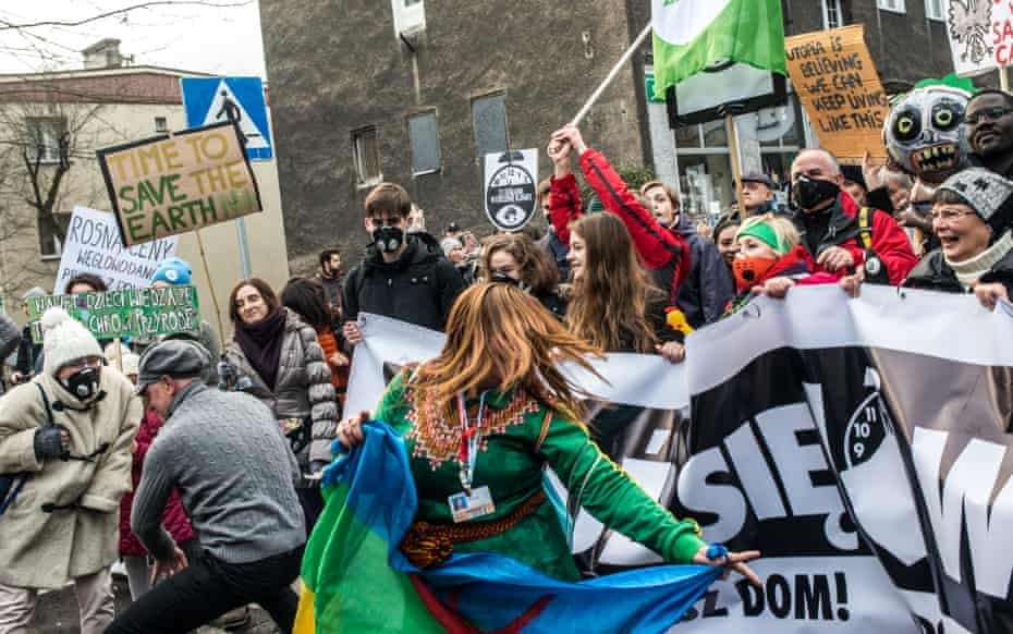 Environmental protesters dance during a Greenpeace-organised march to call for the political and economic reforms in Katowice, Poland.