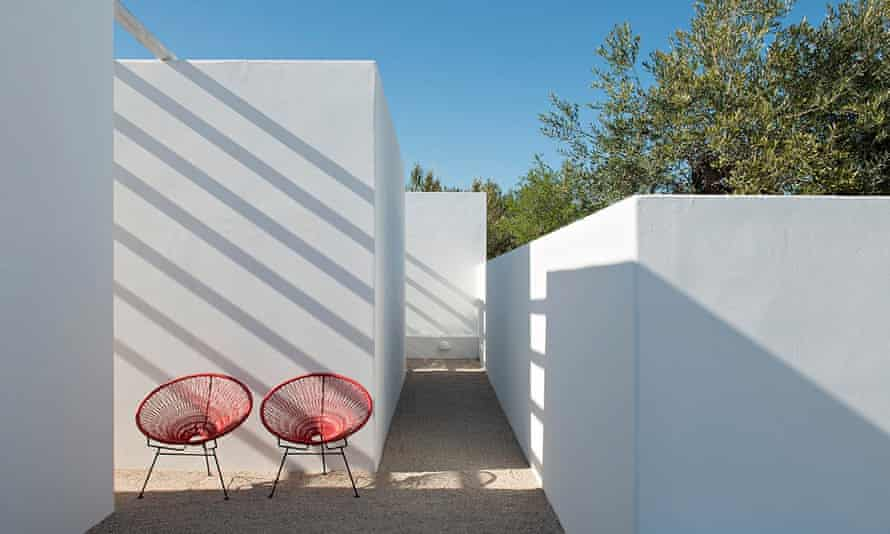 Two red  chairs and white walls at the Pensao Agricola in the Algarve