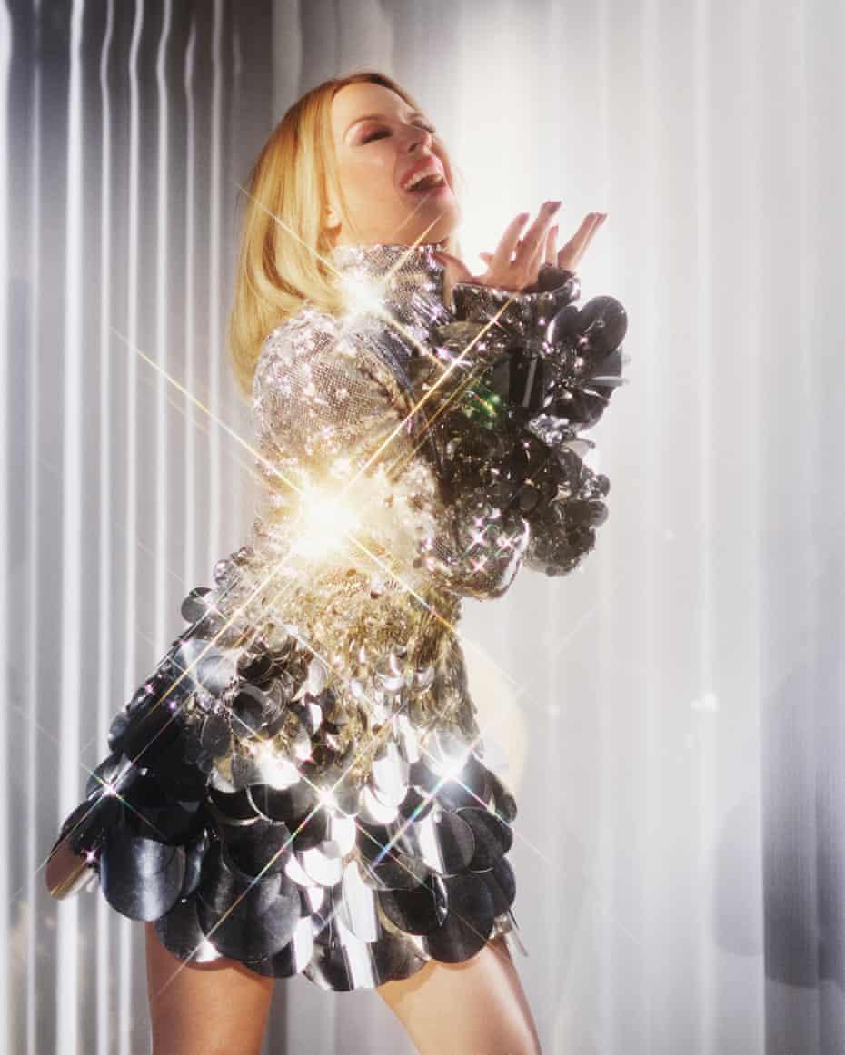 Kylie Minogue in a silver sequin mini dress. Stylist: Karl Willett. Hair and makeup: Christian Vermaak. Manicurist: Adam Slee. Set design: Paulina Piipponen. Stylist's assistant: Adele Pentland. Dress by Christian Cowan.