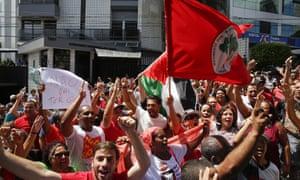 Crowd of demonstrators waving flags