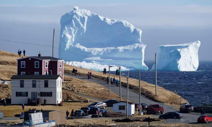Residents view the first iceberg of the season as it passes the south shore, also known as 'iceberg alley', near Ferryland, Newfoundland.