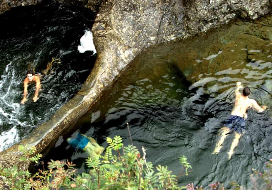 Splashing in the Fairy Pools on Skye.