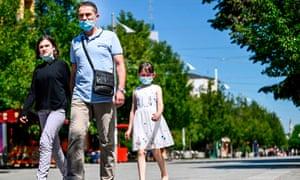 A family in Kosovo walk in downtown Pristina.