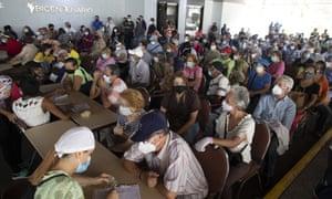 Senior citizens wait for their first dose of the Sputnik V vaccine in Caracas, Venezuela.