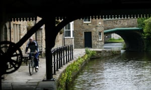 A cyclist on the Leeds-Liverpool canal towpath.
