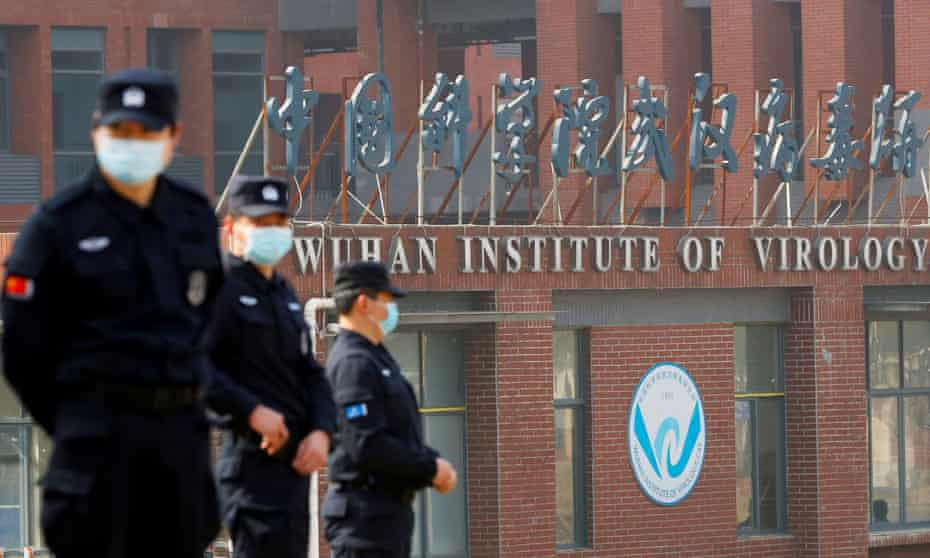 Security staff keep watch outside the Wuhan Institute of Virology in February 2021 during a visit by the World Health Organization team who investigated the origins of Covid-19.