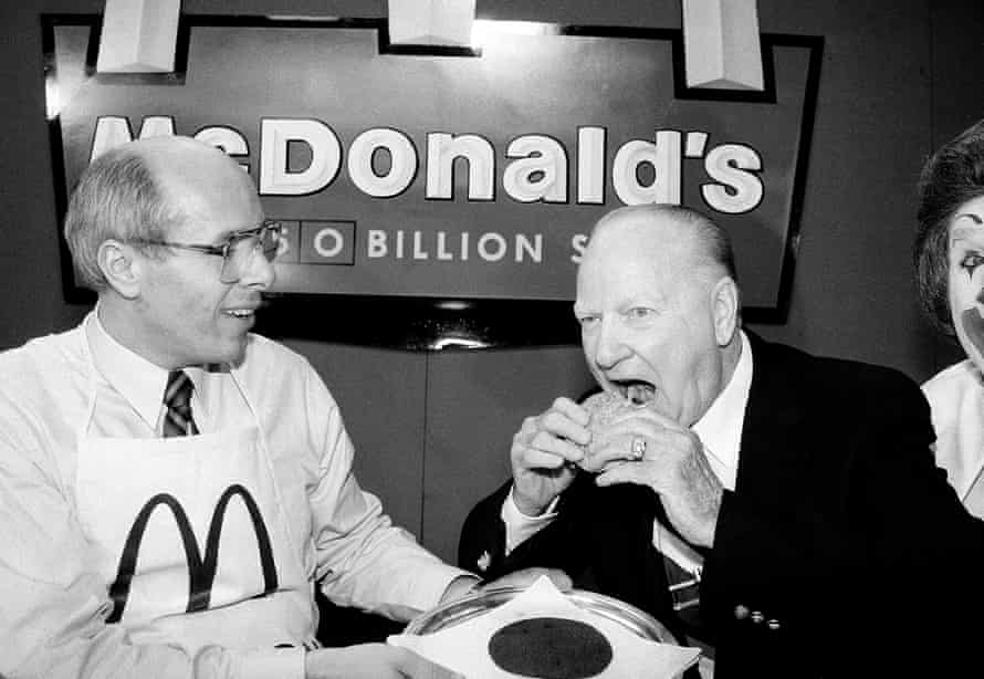 Two days before the shareholders' annual meeting, former US boss Ed Rensi (left) told Fox Business that 'it's cheaper to buy a $35,000 robotic arm than it is to hire an employee who's inefficient, making $15 an hour bagging french fries'.