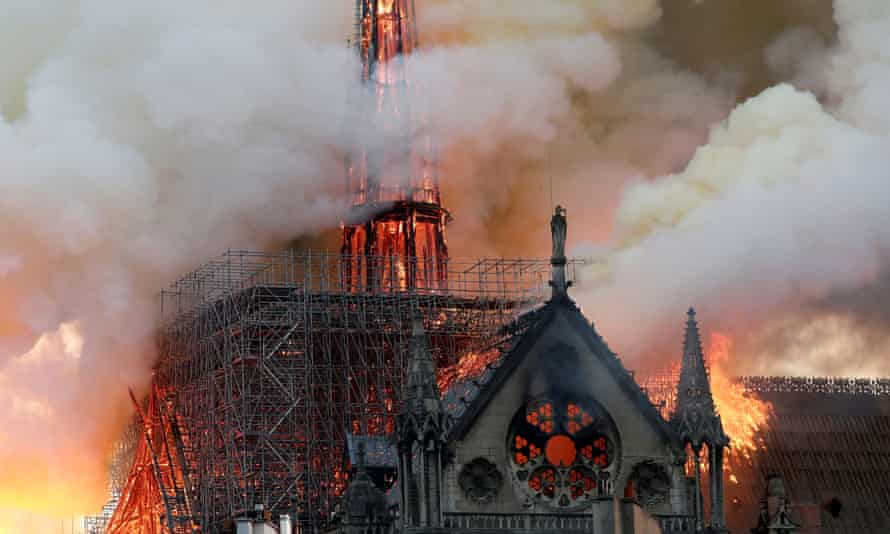 Smoke billows as fire engulfs the spire of Notre Dame cathedral on 15 April 2019.