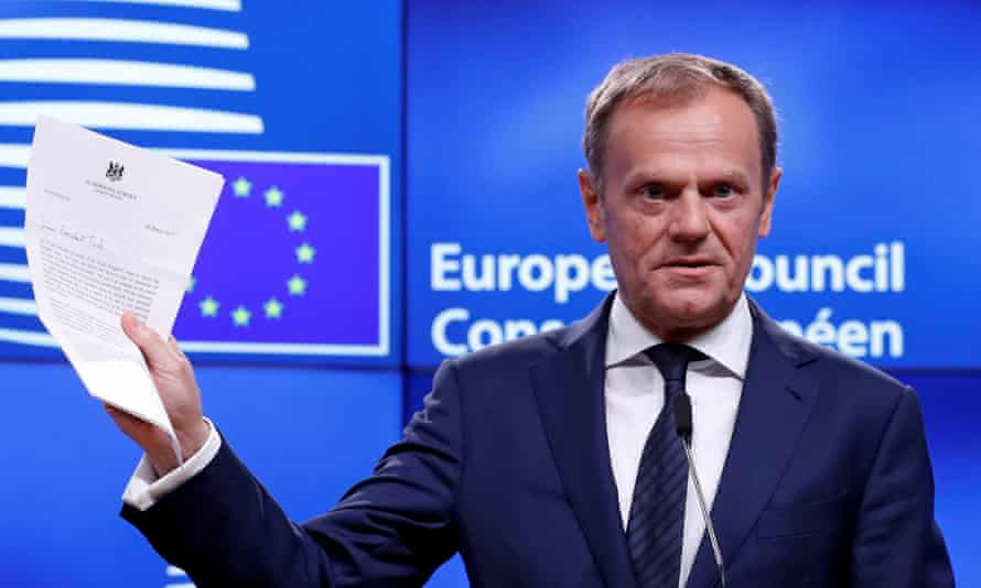 European council president Donald Tusk holds Theresa May's article 50 letter at a Brussels news conference.