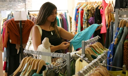 A picture of a woman browsing in a charity shop