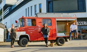 Bristol Food Union, from left, Aine Morris, Steph Wetherell and Josh Eggleton with the Vegetable Diva firetruck used to deliver food around the city.