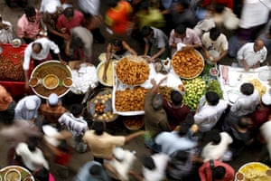 Bangladesh street vendors sell different foods on the first day of the Muslim holy month of Ramadan at Chawkbazar in Dhaka.