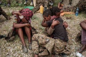 Soldiers console each other upon arrival at the centre.